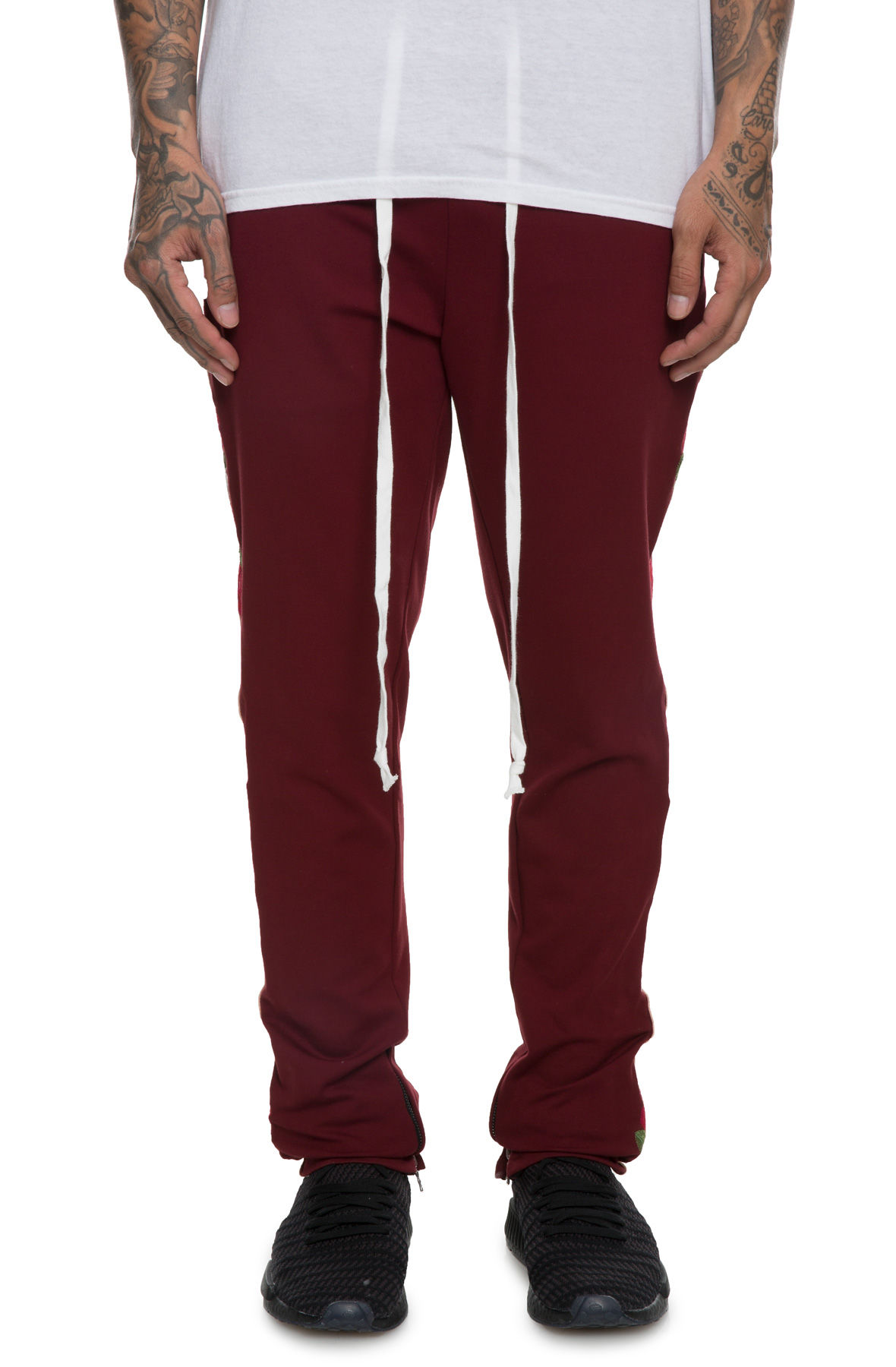 Image of The Bowie Floral Rose Track Pants in Burgundy
