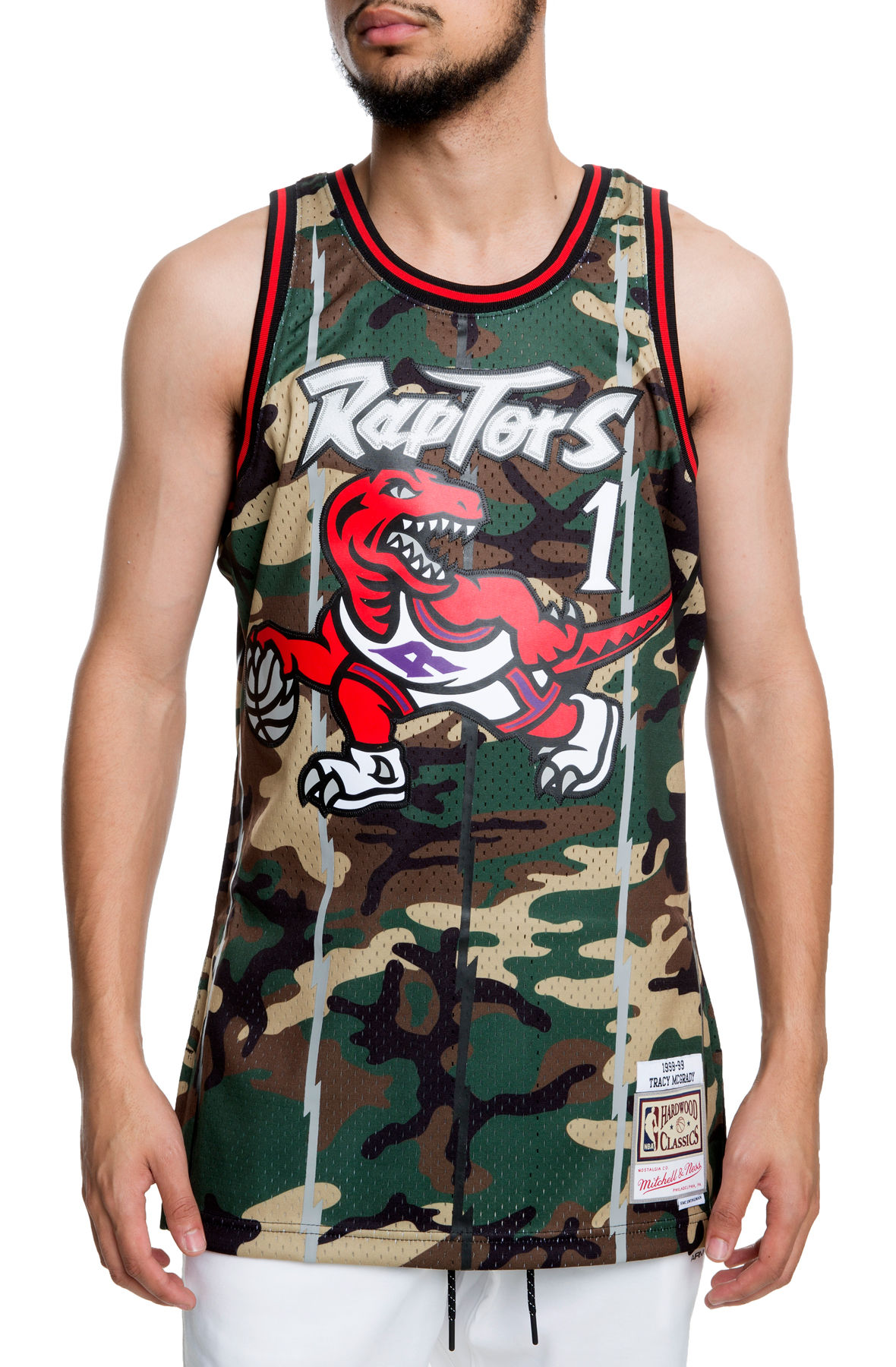 separation shoes 006d5 0e271 The Toronto Raptors Tracy McGrady Jersey in Woodland Camo