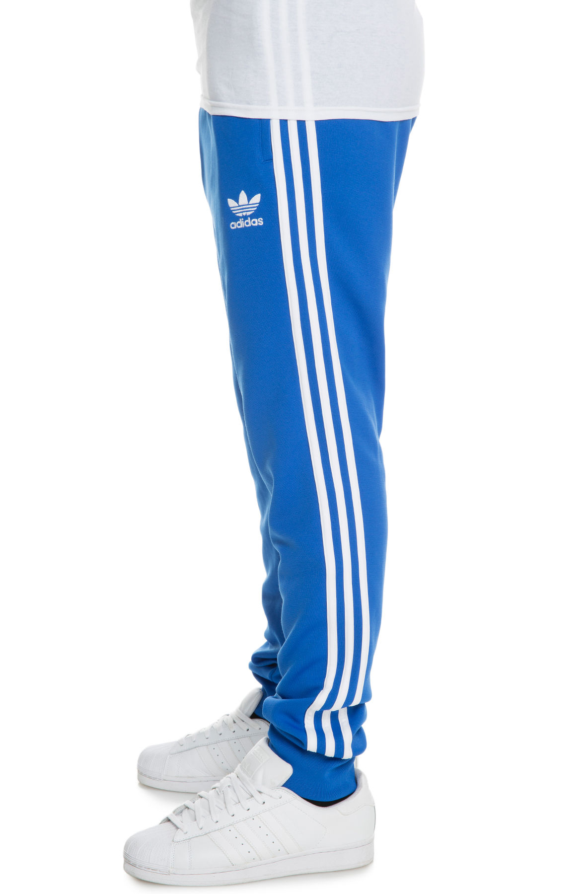 cf502756f3b3 The Adidas Originals SST Cuffed Trackpants in Blue