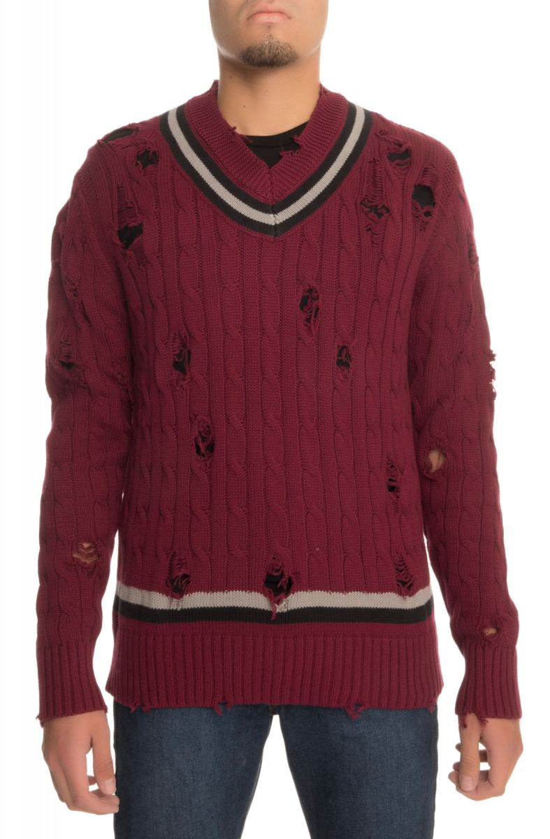 The Distressed Cable Knit Sweater In Burgundy