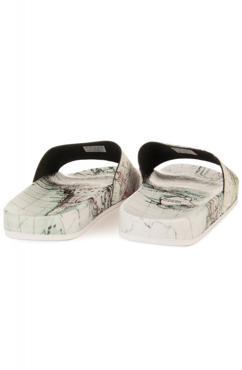 official photos ae054 b89f1 ... The adidas x Eddie Huang Adilette Slide in White Vapour, White Vapour  and Solar Pink