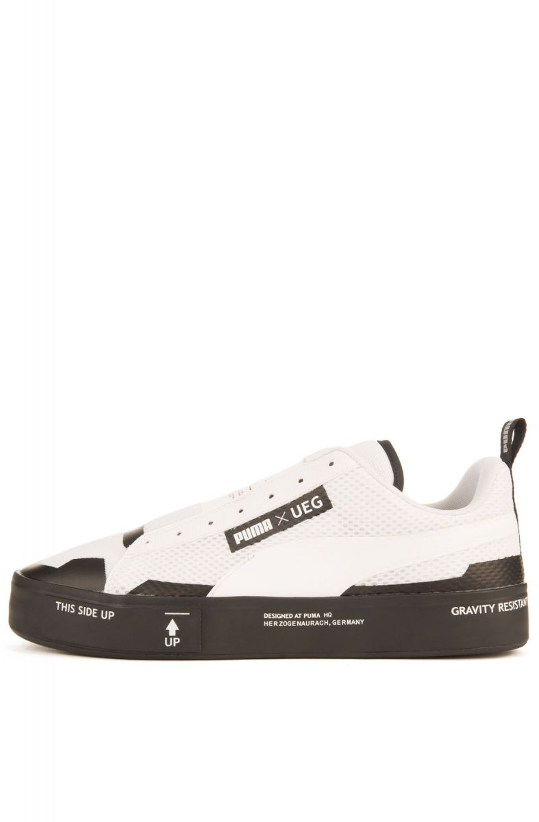buy online 7e3a0 90961 The Puma x UEG Court Play Slip On Sneaker in White and Black White   Black  ...